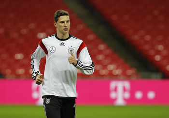 Hi-res-450384529-julian-draxler-of-germany-warms-up-during-a-training_display_image