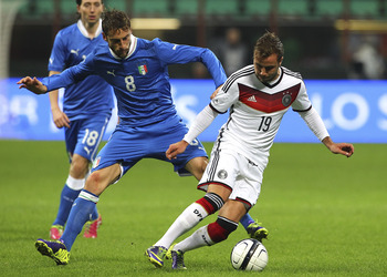 Hi-res-188115960-mario-gotze-of-germany-compete-for-the-ball-with_display_image