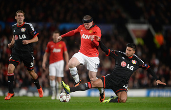 Hi-res-180898981-wayne-rooney-of-manchester-united-is-challenged-by-emre_display_image