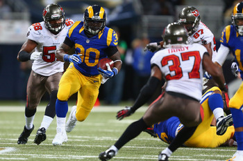 Hi-res-458910421-zac-stacy-of-the-st-louis-rams-runs-against-the-tampa_display_image