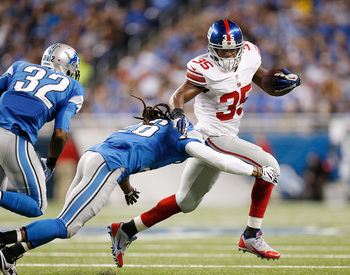 Hi-res-458911739-andre-brown-of-the-new-york-giants-tries-to-get-around_display_image