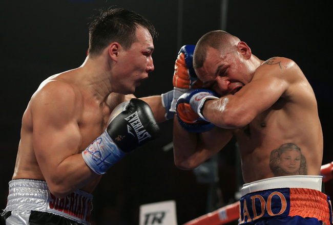 Hi-res-185382270-ruslan-provodnikov-of-russia-delivers-a-punch-to-mike_crop_650x440