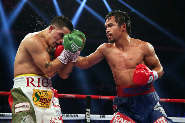 Hi-res-451656295-manny-pacquiao-of-the-philippines-punches-brandon-rios_crop_650