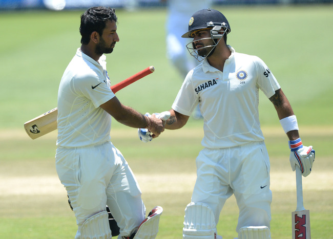 Hi-res-458334619-cheteshwar-pujara-of-india-shakes-hands-with-virat_crop_650