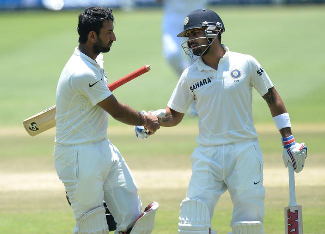 Hi-res-458334619-cheteshwar-pujara-of-india-shakes-hands-with-virat_crop_650