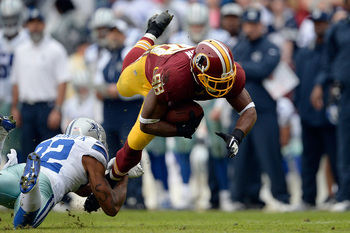 Hi-res-458910819-pierre-garcon-of-the-washington-redskins-is-tackled-by_display_image