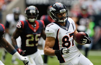 Hi-res-458894135-eric-decker-of-the-denver-broncos-runs-with-the-ball_display_image