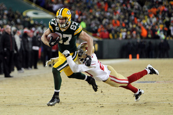 Hi-res-460838363-jordy-nelson-of-the-green-bay-packers-runs-for-a-first_display_image