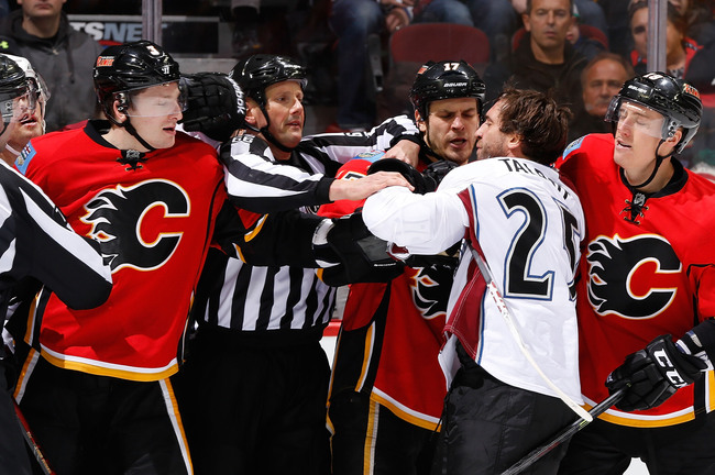 Hi-res-454059433-ladislav-smid-of-the-calgary-flames-and-max-talbot-of_crop_650