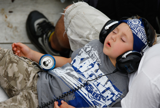 Hi-res-173409018-young-racing-fan-sleeps-in-someones-lap-during-the_crop_650