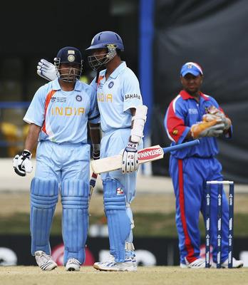 Hi-res-73633084-sachin-tendulkar-of-india-is-congratulated-by-rahul_display_image