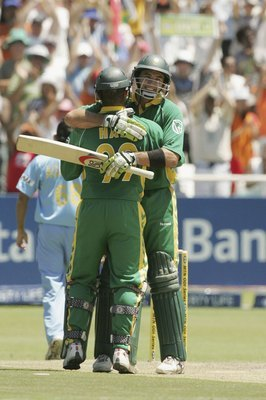 Hi-res-72647603-andrew-hall-congratulates-justin-kemp-of-south-africa-on_display_image