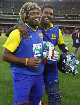 Hi-res-106471460-lasith-malinga-and-angelo-mathews-of-sri-lanka_display_image