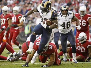 Hi-res-454342863-running-back-zac-stacy-of-the-st-louis-rams-high-steps_display_image