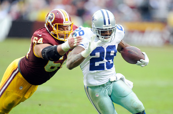Hi-res-458909991-demarco-murray-of-the-dallas-cowboys-is-tackled-in-the_display_image
