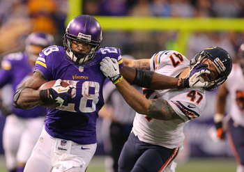 Hi-res-452804569-adrian-peterson-of-the-minnesota-vikings-carries-the_display_image