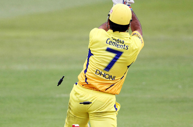 Hi-res-154561146-dhoni-of-chennai-is-bowled-during-the-champions-league_crop_650