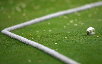Hi-res-80879382-white-one-day-match-ball-rests-near-the-boundary-rope_display_image
