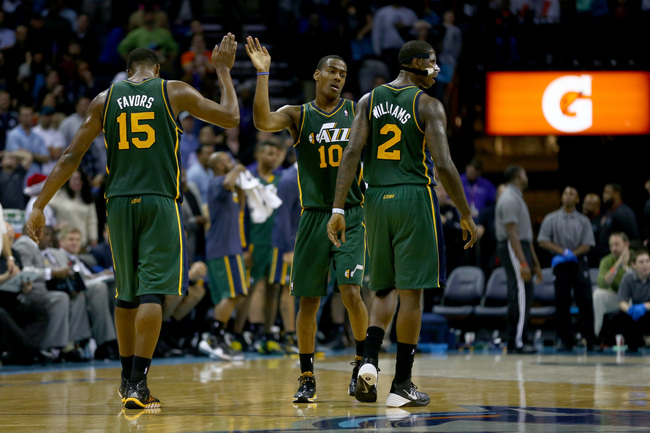 Hi-res-458781393-teammates-derrick-favors-alec-burks-and-marvin-williams_crop_650