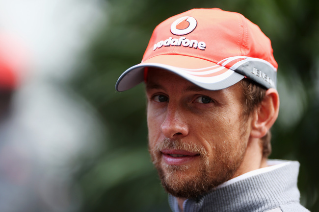 Hi-res-188009288-jenson-button-of-great-britain-and-mclaren-talks-to-the_crop_650
