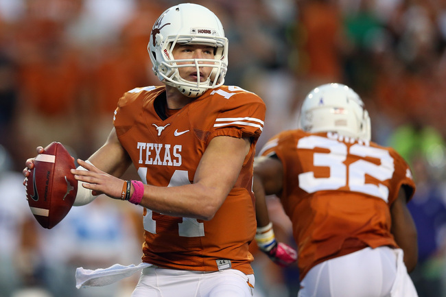 Hi-res-181486864-david-ash-of-the-texas-longhorns-throws-against-the_crop_650