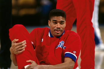 Hi-res-461675609-pervis-ellison-of-the-washington-bullets-stretches_display_image