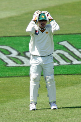 Hi-res-108061429-adnan-akmal-keeper-for-pakistan-holds-onto-his-hat-in-a_display_image