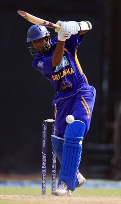 Hi-res-77312623-dilruwan-perera-of-sri-lanka-attacks-the-bowling-of_display_image