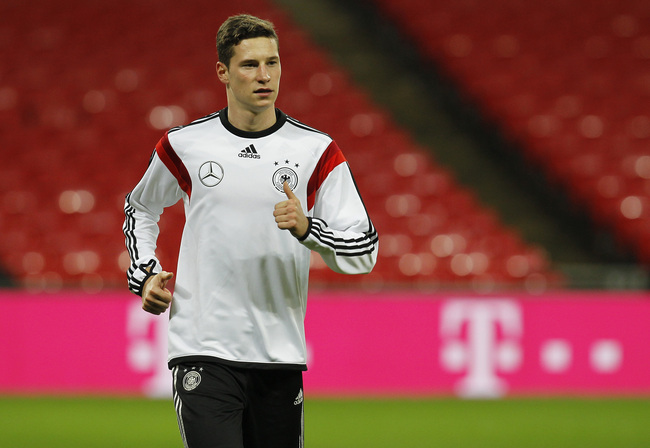 Hi-res-450384529-julian-draxler-of-germany-warms-up-during-a-training_crop_650