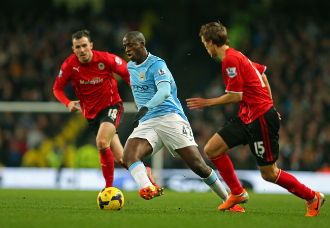 Hi-res-463486535-yaya-toure-of-manchester-city-is-closed-down-by-jordon_crop_650