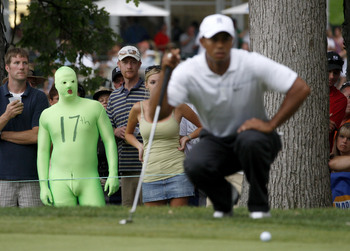 Hi-res-89556560-fan-dressed-in-a-green-body-suit-watches-tiger-woods_display_image