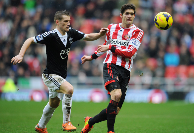 Hi-res-463472557-marcos-alonso-of-sunderland-battles-with-steven-davis_crop_650