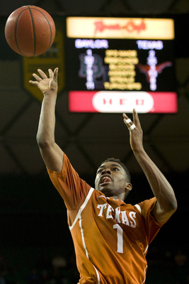 Hi-res-465025371-isaiah-taylor-of-the-texas-longhorns-drives-to-the_display_image