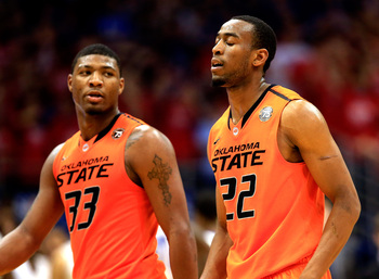 Hi-res-463535235-marcus-smart-and-markel-brown-of-the-oklahoma-state_display_image