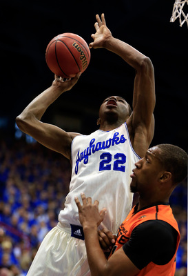 Hi-res-463535867-andrew-wiggins-of-the-kansas-jayhawks-shoots-over_display_image