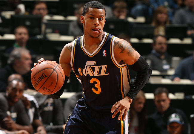Hi-res-464069175-trey-burke-of-the-utah-jazz-dribbles-the-ball-against_crop_650