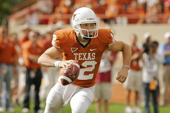 Hi-res-92944833-quarterback-colt-mccoy-of-the-texas-longhorns-rolls-out_display_image