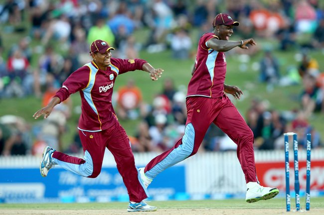 Hi-res-461349675-jason-holder-of-the-west-indies-celebrates-his-runout_crop_650