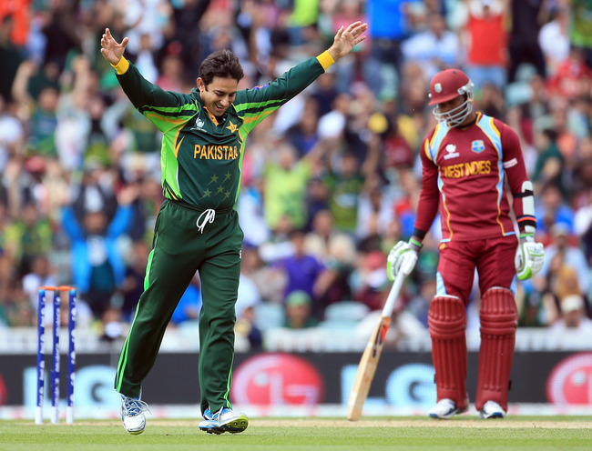 Hi-res-170114013-saeed-ajmal-of-pakistan-celebrates-taking-the-wicket-of_crop_650