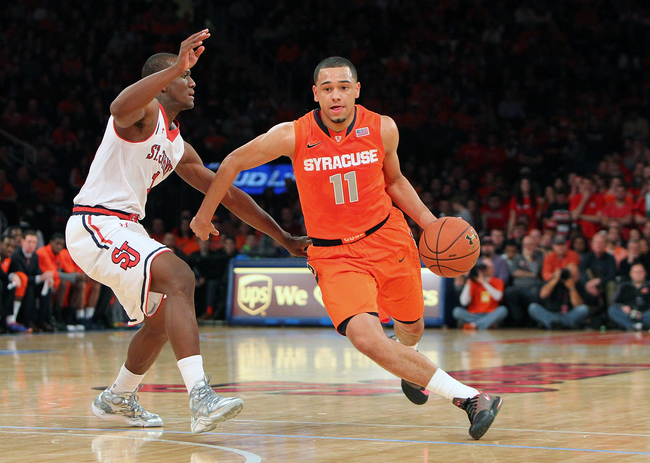 Hi-res-456858363-tyler-ennis-of-the-syracuse-orange-drives-the-ball-down_crop_650