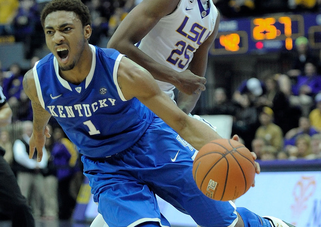 Hi-res-465707595-james-young-of-the-kentucky-wildcats-is-fouled-by_crop_650