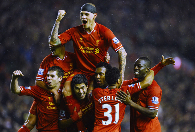 Hi-res-465743901-martin-skrtel-of-liverpool-jumps-on-the-shoulders-of_crop_650x440