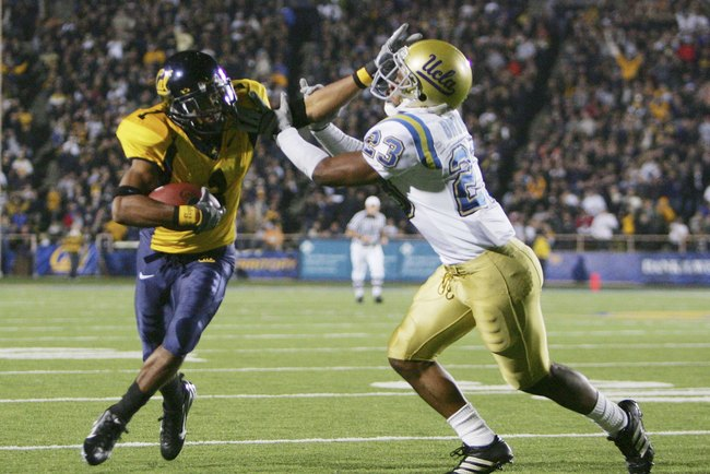 BERKELEY, CA - NOVEMBER 04:  Wide receiver DeSean Jackson #1 of the California Golden Bears stiff arms  Trey Brown #23 of the UCLA Bruins in the second half at Memorial Stadium during the game on November 4, 2006 in Berkeley, California. Cal defeated UCLA