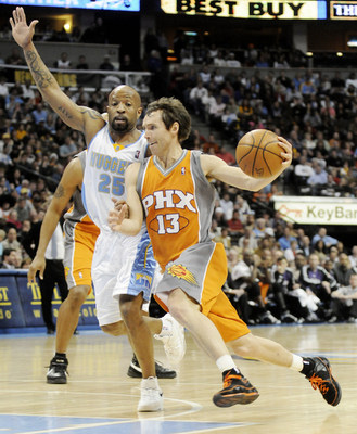 April 1, 2008 Steve Nash of the Phoenix Suns drives against Anthony Carter of the Denver Nuggets during the third period of their game at the Pepsi Center in Denver, CO. Denver won 126-120.