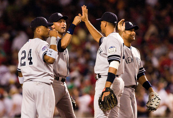 25 July 2008: Robinson Cano (24), Derek Jeter, Alex Rodriguez, and Bobby Abreu congratulate each other after the New York Yankees win over the Boston Red Sox 1-0 at Fenway Park in Boston, MA.