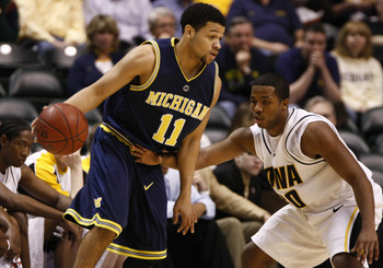 13 MAR 2008: Michigan guard David Merritt guarded by Iowa Hawkeyes guard Tony Freeman (11) during the Michigan Wolverines 55-47 win over the  Iowa Hawkeyes at Conseco Fieldhouse in Indianapolis, Indiana.