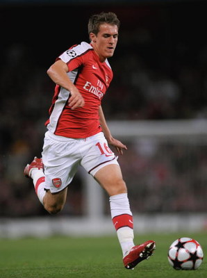 LONDON, ENGLAND - AUGUST 26:  Aaron Ramsey of Arsenal runs with the ball during the UEFA Champions League 2nd qualifying round 2nd leg match between Arsenal and Celtic at the Emirates Stadium on August 26, 2009 in London, England.  (Photo by Shaun Botteri
