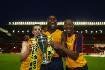 LIVERPOOL, ENGLAND - MAY 26:  (L-R) Arsenals Jack Wilshere, Jay Emmanuel Thomas and Sanchez Watt celebrate winning the FA Youth Cup during the second leg of the FA Youth Cup final sponsored by E.ON, between Liverpool and Arsenal at Anfield on May 26, 2009