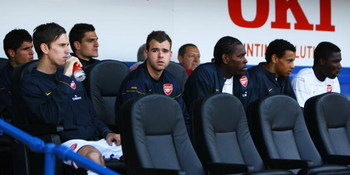 PORTSMOUTH, UNITED KINGDOM - MAY 02:  (L-R) Fran Marida, Mark Randall, Vito Mannone, Amaury Bischoff, Jay Thomas, Francis Coquelin and Emmanuel Frimpong of Arsenal look on from the bench prior to the Barclays Premier League match between Portsmouth and Ar
