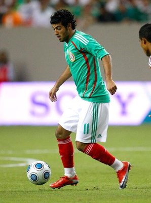 ATLANTA - JUNE 24:  Carlos Vela #11 of Mexico against Venezuela during their international friendly match at Georgia Dome on June 24, 2009 in Atlanta, Georgia.  (Photo by Kevin C. Cox/Getty Images)